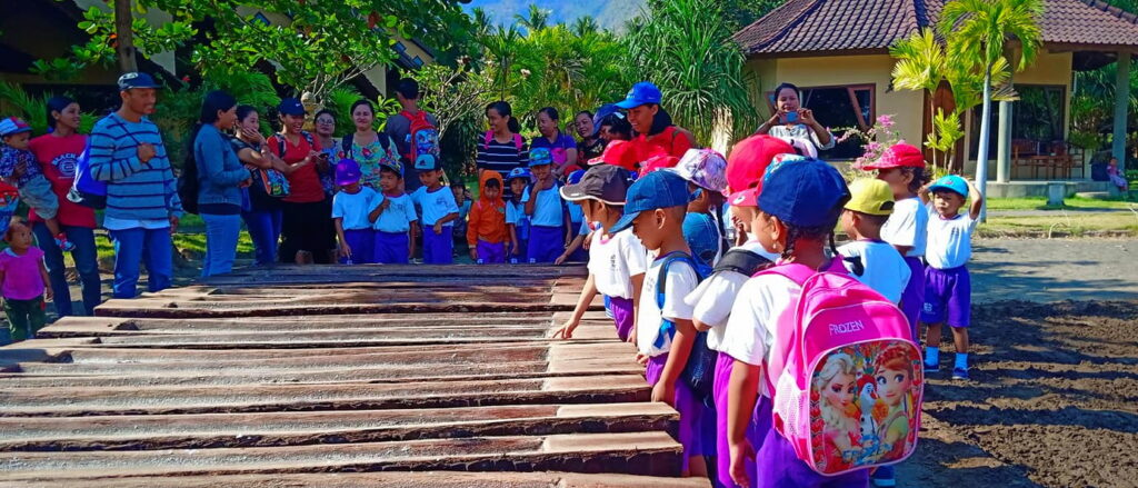 ECO policy & concept - children from loacl kindergarten learn about traditional salt panning