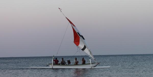 sailing with outrigger boat Jukung