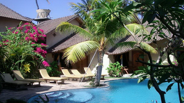 Poolside Bungalows with ceiling fan in Hotel Uyah Amed Bali